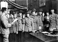 0528525 © Granger - Historical Picture ArchiveWOMEN MARINES, 1918.   Women being sworn in to the United States Marine Corps, where they will take over office duties from male Marines. Left to right: Lieutenant George Kneller, Violet Van Wagner, Marie Schleight, Florence Wiedinger, Isabelle Balfour, Janet Kurgan, Edith Barton, and Helene Constance Dupont. Photograph, 1918.