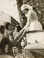 0528920 © Granger - Historical Picture ArchiveWWI: FRANCE, 1918.   Mary Withers of the American Red Cross giving out cigarettes and chocolate to American soldiers on their way to the trenches near Montmirail, France. Photograph, 31 May 1918.