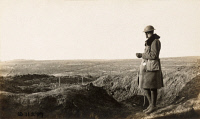 0528975 © Granger - Historical Picture ArchiveWWI: BATTLEFIELD, 1918.   An American soldier overlooking the Chemin des Dames battlefield, watching shells burst around Fort Malmaison in France. Photograph, 13 March 1918.