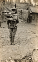 0528983 © Granger - Historical Picture ArchiveWWI: PIGEONS, 1918.   An American Marine taking carrier pigeons to the trenches in Sommedieue, France. Photograph, 30 April 1918.