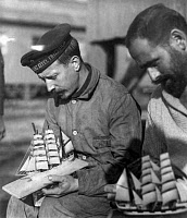 0621775 © Granger - Historical Picture ArchiveWWI: GERMAN PRISONERS, c1918.   Two German sailor prisoners of war, one wearing a cap of the SS Prinz Eitel Friedrich, building miniature boats. Photographed at Fort McPherson, Georgia, c1918.