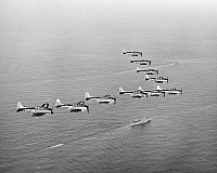 0002662 © Granger - Historical Picture ArchiveWORLD WAR II: U.S. BOMBERS.   A flying wedge of U.S. Douglas Dauntless dive bombers in the Battle of Midway, June 1942, in which the airplanes sank four Japanese carriers.