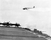 0016186 © Granger - Historical Picture ArchiveWORLD WAR II: KAMIKAZE, 1944.   A Japanese kamikaze is hit and diverted from its suicide dive on the aircraft carrier U.S.S. Ommaney Bay in the Sulu Sea during World War II, December 1944.