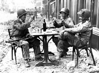 0016405 © Granger - Historical Picture ArchiveWORLD WAR II: PARIS, 1944.   Three American soldiers at a sidewalk cafe in Paris, France, following the Allied liberation of the city, August 1944.