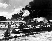 0016621 © Granger - Historical Picture ArchiveWORLD WAR II: PEARL HARBOR.  Wreckage at an air station after the Japanese attack on 7 December 1941.