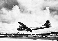 0027268 © Granger - Historical Picture ArchiveWORLD WAR II: ENOLA GAY.   The B-29 'Enola Gay' landing at Tinian in the Marianas Islands after dropping the first atomic bomb on Hiroshima, Japan, on 6 August 1945.
