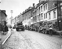 0036355 © Granger - Historical Picture ArchiveWWII: BELGIUM, 1944.   European Ground Combat. Tanks of the American First Army in the streets of Malmedy, Belgium, moving to help stem the strong German counter-offensive in the area, December 1944.
