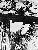 0038880 © Granger - Historical Picture ArchiveWORLD WAR II: GERMAN ARMY.   A German soldier in a trench surrounded by Soviet troops, February 1943.