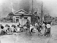 0056696 © Granger - Historical Picture ArchiveWORLD WAR II: HIROSHIMA.   Victims of the first atomic bomb wait to receive medical aid in the southern part of the shattered city of Hiroshima, 6 August 1945.