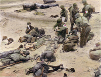 0064591 © Granger - Historical Picture ArchiveWORLD WAR II: D-DAY, 1944.   American medics administer first aid to soldiers wounded in the initial attack at Omaha Beach during the invasion of Normandy, France, 9 June 1944. Oil over a photograph.