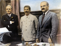 0078334 © Granger - Historical Picture ArchiveNAZI-SOVIET PACT, 1939.   Joachim von Ribbentrop (left), German Minister for Foreign Affairs, Joseph Stalin (center), and Soviet Foreign Minister Vyacheslav Molotov (right), after the signing of the Nazi-Soviet non-aggression pact at Moscow, 23 August 1939. Oil over a photograph.
