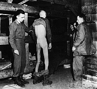 0099765 © Granger - Historical Picture ArchiveWORLD WAR II: STALAG XII.   An emaciated American prisoner of war at Stalag XII, in the area of Limburg, Germany, shown after the liberation of the camp by Allied forces. Photographed April 1945.