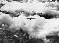 0099771 © Granger - Historical Picture ArchiveWORLD WAR II: THUNDERBOLT.   An entire squadron of P-47 Thunderbolts flying over the English Channel as escorts to B-17 Flying Fortresses on a bombing mission. Photographed 1943.