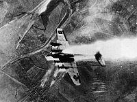 0099775 © Granger - Historical Picture ArchiveWORLD WAR II: B-17, 1944.   B-17 Flying Fortress of the U.S. 8th Air Force shot down on a bombing mission over Merseburg, Germany. Photographed 1944.