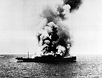 0099987 © Granger - Historical Picture ArchiveWORLD WAR II: FREIGHTER.   A Japanese freighter burns off the coast of Australia, set on fire by the crew when spotted by the Australian navy. Photographed 1942.