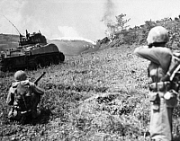 0100207 © Granger - Historical Picture ArchiveWORLD WAR II: OKINAWA.   Flame-throwing tank and U.S. Marines rifleman moving up to the front lines during the Battle of Okinawa, 11 May 1945.