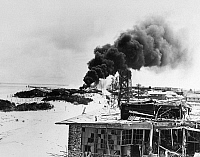 0100213 © Granger - Historical Picture ArchiveWORLD WAR II: MIDWAY, 1942.   View of the damage done to the U.S. Naval base on Midway Island during the Battle of Midway, 3-6 June 1942.