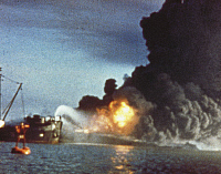 0100303 © Granger - Historical Picture ArchiveWORLD WAR II: PEARL HARBOR.   The fight to extinguish oil fires at the U.S. naval base at Pearl Harbor, Hawaii, following the Japanese attack on 7 December 1941.