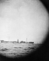 0100639 © Granger - Historical Picture ArchiveWORLD WAR II: SUBMARINE.   A Japanese merchant ship sinking following an American submarine attack. Periscope photograph taken by the USS Skipjack, October 1942.