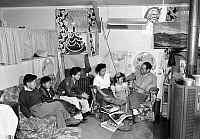 0111578 © Granger - Historical Picture ArchiveJAPANESE INTERNMENT, 1943.   Japanese-American family at their house at the Manzanar Relocation Center at Owens Valley, California. Photographed by Ansel Adams, 1943.