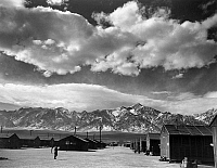 0114753 © Granger - Historical Picture ArchiveJAPANESE INTERNMENT, 1943.   Street and barracks at the Manzanar Relocation Center for Japanese-Americans at Owens Valley, California. Photograph by Ansel Adams, 1943.