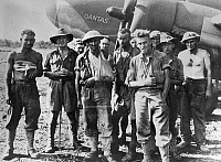 0114999 © Granger - Historical Picture ArchiveWORLD WAR II: AUSTRALIA.   Australian wounded soldiers posing before boarding a Quantas flying boat that will take them from Popondetta, New Guinea to Port Moresby, Papua. Photograph, c1943, during the New Guinea Campaign.