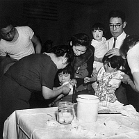0115200 © Granger - Historical Picture ArchiveJAPANESE INTERNMENT, 1942.   Two young Japanese American girls being inoculated as they register for relocation, in San Francisco, California, April 1942.