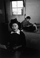 0115239 © Granger - Historical Picture ArchiveJAPANESE INTERNMENT, 1943.   Office workers Rose Fukuda and Roy Takeda, at the Manzanar Relocation Center for Japanese Americans, near Owens Valley, California. Photograph by Ansel Adams, 1943.