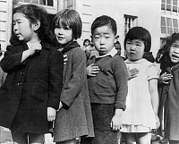 0115274 © Granger - Historical Picture ArchiveFLAG CEREMONY, 1942.   Group of first-graders, many of them Japanese Americans, reciting the Pledge of Allegiance at the Raphael Weill School in San Francisco, California. Photograph by Dorothea Lange, April 1942.