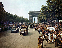 0117743 © Granger - Historical Picture ArchiveWORLD WAR II: PARIS, 1944.   Crowds of French patriots lining the Champs Elysees to view Allied tanks and half tracks pass by the Arc du Triomphe, after Paris was liberated on 26 August 1944. Photographed by Jack Downey.