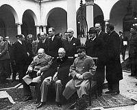 0132808 © Granger - Historical Picture ArchiveYALTA CONFERENCE, 1945.   Allied leaders photographed at the Livadia Palace at Yalta, Crimea, during the Yalta Conference, February 1945. Seated from left: British Prime Minister Winston Churchill, U.S. President Franlin Roosevelt, and Soviet Premier Joseph Stalin.