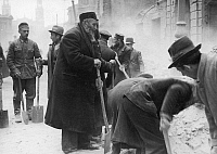 0166633 © Granger - Historical Picture ArchiveWARSAW GHETTO UPRISING.   An old man is forced to clear rubble after the uprising in the Warsaw Ghetto in 1943.