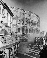 0166643 © Granger - Historical Picture ArchiveWORLD WAR II: COLOSSEUM.   American troops of the Fifth Army pass the Colosseum in Rome at the start of the Allied occupation, 5 June 1944.