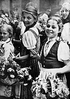 0166660 © Granger - Historical Picture ArchiveGERMAN YOUTH, 1930s.   Young German girls with baskets of flowers. Photograph by Heinrich Hoffmann, 1930s.