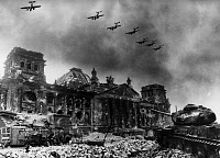 0167121 © Granger - Historical Picture ArchiveWORLD WAR II: BERLIN, 1945.   Ruins of the Reichstag in Berlin, with Soviet airplanes flying in formation above, May 1945 Photographed by Yevgeny Khaldei, possibly a photo-montage. Full credit: Voller Ernst - ullstein bild / Granger, NYC -- All Rights Reserved.