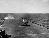 0167208 © Granger - Historical Picture ArchiveWWII: AIRCRAFT CARRIER.   An F6F Hellcat carrying a bomb lands on an aircraft carrier, 1945.
