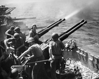 0167220 © Granger - Historical Picture ArchiveWWII: ANTI-AIRCRAFT GUNS.   Crew members on board a U.S. Navy aircraft carrier fire anti-aircraft guns at Japanese planes in the Pacific Ocean, 1943.