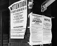 0167300 © Granger - Historical Picture ArchiveJAPANESE RELOCATION, 1942.   Signs calling for the evacuation of Japanese immigrants and announcing the nearest air raid shelter in San Francisco, California. Photograph, April 1942.