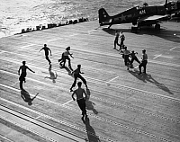 0167301 © Granger - Historical Picture ArchiveAIRCRAFT CARRIER: LEISURE.   Crew members of the aircraft carrier USS Hornet, playing touch football on the flight deck, February 1945.