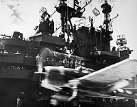 0167302 © Granger - Historical Picture ArchiveWWII: AIRCRAFT CARRIER.   A fighter plan takes off from a U.S. Navy aircraft carrier during World War II. Photograph, c1943.