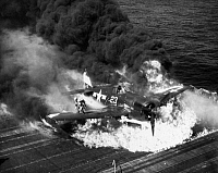 0167304 © Granger - Historical Picture ArchiveWWII: CRASH LANDING, 1945.   The pilot of a U.S. Navy F6F Hellcat escapes after a crash landing on the USS Lexington aircraft carrier, 1945.