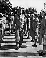 0167352 © Granger - Historical Picture ArchiveWWII: WOMEN'S ARMY CORPS.   General Dwight D. Eisenhower reviewing members of the Women's Army Auxilliary Corps in North Africa, 1943.