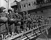 0167354 © Granger - Historical Picture ArchiveWWII: WOMEN'S ARMY CORPS.   Members of the Women's Army Corps disembark at a North African port during World War II. Among the first to land were Lenora Jones, Claire Justice and Martha Kerr. Photograph, 10 January 1944.