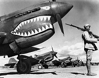 0169631 © Granger - Historical Picture ArchiveWORLD WAR II: CHINA, 1943.   A Chinese soldier guards a squadron of Curtiss P-40 Warhawk fighter planes in China during World War II, 1943.