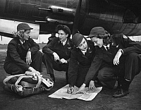 0176722 © Granger - Historical Picture ArchiveWWII: WOMEN PILOTS, c1941.   Four female pilots looking at a chart. Photograph, c1941.