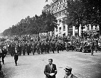 0180589 © Granger - Historical Picture ArchiveWORLD WAR II: PARIS, 1944.   General Charles de Gaulle leading a victory parade on the the Avenue des Champs Elysees, after the liberation of Paris on August 26, 1944. Photograph, 1944.