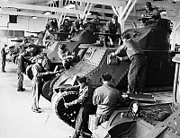 0183662 © Granger - Historical Picture ArchiveWWII: TRAINING, 1942.   Students working on tanks at the Armored Force Replacement Center at Fort Knox, Kentucky. Photograph, 1942.