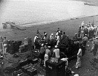 0183729 © Granger - Historical Picture ArchiveWWII: PEARL HARBOR, 1941.   American sailors at Naval Air Station Ford Island reloading ammunition clips and belts during attacks on Pearl Harbor. Photograph. 7 December 1941.