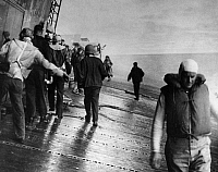 0216221 © Granger - Historical Picture ArchiveWWII: USS YORKTOWN, 1942.   Crewmen of the USS Yorktown preparing to abandon ship after Japanese torpedo plane attacks. Photograph, June 1942.