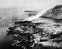 0216494 © Granger - Historical Picture ArchiveWWII: ALEUTIAN ISLANDS, 1943.   Fires on the island of Kinnaw in Chichagof Harbor, Attu in the Aleutian Islands, after combat between Japanese and American forces. Photograph, 1943.